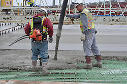 Two Workers on a Concrete Pour at the New Pearl Harbor Memorial Bridge, New Haven Harbor Crossing Corridor. CT DOT Contract B1 Project No. 92-618 Progress Photography. East end of the Northbound West Approaches. Eighth on site photo capture of every four month chronological documentation.