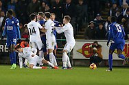 a scuffle breaks out between the players involving Leicester's Robert Huth © as Tom Carroll of Swansea city is left on the ground. . Premier league match, Swansea city v Leicester City at the Liberty Stadium in Swansea, South Wales on Sunday 12th February 2017.<br /> pic by Andrew Orchard, Andrew Orchard sports photography.