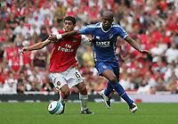 Photo: Lee Earle.<br /> Arsenal v Portsmouth. The FA Barclays Premiership. 02/09/2007.Arsenal's Denilson battles with Sylvain Distin.