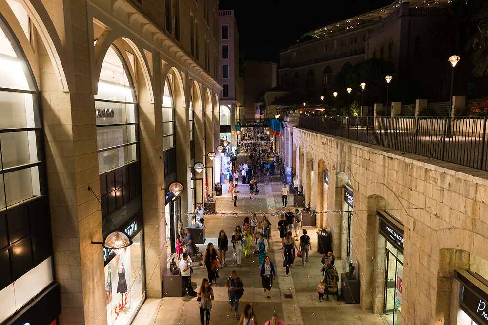 Shoppers are seen at Mamilla Mall, also called Alrov Mamilla Avenue, an upscale shopping street and the only open-air mall in Jerusalem, Israel