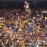 Theodore Pauli, (top), Kawasaki, in action during the 450SX Class Championship during round 16 of the Monster Energy AMA Supercross series held at MetLife Stadium. 62,217 fans attended the event held for the first time at MetLife Stadium, New Jersey, USA. 26th April 2014. Photo Tim Clayton