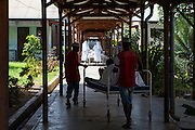 Patients are wheeled to the wards after surgery in St Walburg's Hospital, Nyangao. Lindi Region, Tanzania.