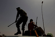 Mcc0030300 . Daily Telegraph..Rebel Libyan fighters in the town of Brega shortly before retreating towards Ajdabiyah..Gaddafi's forces have been rapidly advancing in the past 24 hours and are now approaching Ajdabiyah...Brega 30 March 2011