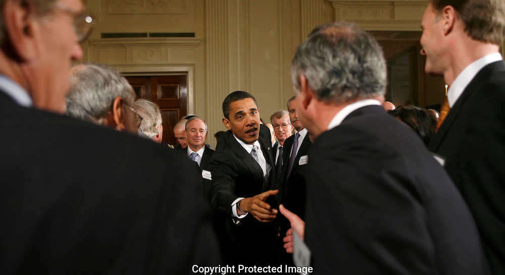 President Barack Obama shakes hands with  members of The Business Council iafter speaking to the Business Council in the East Room of the White House on February 13, 2009.  Photograph: Dennis Brack