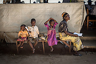 DRC / Burundi Refugees / A woman waits to be registered by UNHCR registration teams at Kavimvira transit<br /> centre in Uvira, DRC's South Kivu Province.<br /> 700 vulnerable Burundian refugees are hosted in Kavimvira transit centre. The<br /> majority are women and children.<br /> <br /> More than 9000 Burundians refugees have crossed into the DRC over the past few weeks. The new<br /> arrivals are being hosted by local families, but the growing numbers are straining<br /> available support. UNHCR is helping some 700 vulnerable refugees at a transit centre<br /> at Kavimvira and in another centre at Sange. Work is ongoing to identify a site<br /> where all the refugees can be moved, and from where they can have access to<br /> facilities such as schools, health centers and with proper security. / UNHCR / F.Scoppa / May 2015