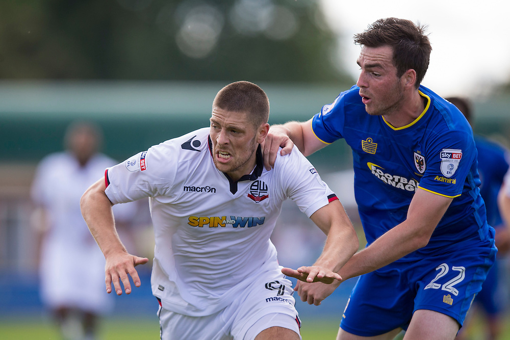 Bolton Wanderers' Jamie Proctor battles with AFC Wimbledon's Sean Kelly<br /> <br /> Photographer Craig Mercer/CameraSport<br /> <br /> Football - The EFL Sky Bet League One - AFC Wimbledon v Bolton Wanderers - Saturday 13th August 2016 - The Cherry Red Records Stadium - London<br /> <br /> World Copyright © 2016 CameraSport. All rights reserved. 43 Linden Ave. Countesthorpe. Leicester. England. LE8 5PG - Tel: +44 (0) 116 277 4147 - admin@camerasport.com - www.camerasport.com