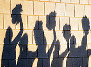 The Winner Warriors cheerleaders cast a shadow on the brick wall below the stands as they cheer during the Class 11B state football finals on Friday, Nov. 15, 2019, at the Dana J. Dykehouse Stadium in Brookings.
