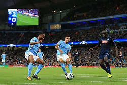 17th October 2017 - UEFA Champions League - Group F - Manchester City v Napoli - Raheem Sterling of Man City (L) and teammate Gabriel Jesus battle with Kalidou Koulibaly of Napoli - Photo: Simon Stacpoole / Offside.