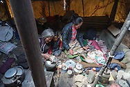 A Tibetan woman pours tea while her daughter looks after her granddaughter in a nomad tent in the village of Puga in Ladakh.