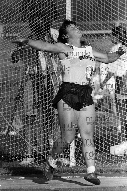******This is an unprocessed scan from the negative. You can buy it as is and clean it up yourself, or contact us for rates on providing the service for you. *******<br /> <br /> (Montreal, Canada --- 25 July 1995) Theresa Brick in the discus at the 1995 Canadian National Track and Field Championships held at the Complexe sportif Claude-Robillard in Montreal. Photo 1995 Copyright Sean Burges / Mundo Sport Images.<br /> <br /> ******This is an unprocessed scan from the negative. You can buy it as is and clean it up yourself, or contact us for rates on providing the service for you. *******