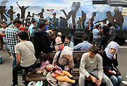 Migrants wait on the platform Keleti train station in Budapest, Hungary, September 3 2015. An estimated 3,000 people were believed to be camped out at the station as authorities opened the doors to those without European visas or travel documents to board trains.