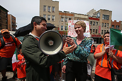 May 5, 2018 - New York City, New York, United States - Councilmember Menchaca passes bullhorn over to Cynthia Nixon...NY Communities for Change joined NY City Council member for Sunset Park Carlos Menchaca & NYS gubernatorial candidate Cynthia Nixon for a rally & march opposing ICE's recent raids, and demanding support for the Liberty Act, which would prevent the state from cooperating with federal immigration authorities among other regulations. (Credit Image: © Andy Katz/Pacific Press via ZUMA Wire)
