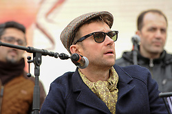 "© Licensed to London News Pictures. 26/02/2017. London, UK. Damon Albarn, Blur singer, on stage with The Orchestra of Syrian Musicians ahead of the special premiere free screening of the Oscar-nominated, Best Foreign Language Film, ""The Salesman"", in Trafalgar Square, hosted by Mayor of London, Sadiq Khan.  The film's Iranian director, Asghar Farhadi, decided to boycott tonight's main Oscars ceremony in Hollywood, in solidarity with those affected by President Donald Trump's travel ban on people from seven Muslim majority countries (including Iran) from entering the USA.   Photo credit : Stephen Chung/LNP"
