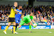 Burton Albion goalkeeper Stephen Bywater (1) saves from Cardiff City midfielder Junior Hoilett (33) during the EFL Sky Bet Championship match between Burton Albion and Cardiff City at the Pirelli Stadium, Burton upon Trent, England on 5 August 2017. Photo by Richard Holmes.