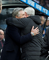 Football - 2019 / 2020 Premier League - Newcastle United vs. Everton<br /> <br /> Everton manager Carlo Ancelotti and Newcastle United manager Steve Bruce embrace before kick off, at St James' Park Stadium.<br /> <br /> COLORSPORT/BRUCE WHITE