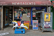 Newsagents shop front in London. The usual chaotic scene.