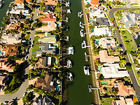 Aerial view of homes and boats in a canal subdivision, Birkdale, Queensland, Australia