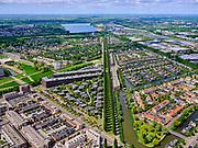 Nederland, Utrecht, Utrecht; 14–05-2020; stadsdeel Leidsche Rijn, gezien vanuit de wijk Terwijde met het Waterwinpark. Zicht op de bomenrij van de Rijnkennemerlaan, richting Haarrijnse Plas.<br /> Leidsche Rijn district, Terwijde district in the foreground. View on the trees of the De Rijnkennemerlaan.<br /> <br /> luchtfoto (toeslag op standaard tarieven);<br /> aerial photo (additional fee required)<br /> copyright © 2020 foto/photo Siebe Swart