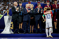 FIFA President Gianni Infantino, Russia President Vladimir Putin, France President Emmanuel Macron, Croatia President Kolinda Grabar-Kitarovic hugs Luka Modric during the trophies ceremony after the 2018 FIFA World Cup Russia, final football match between France and Croatia on July 15, 2018 at Luzhniki Stadium in Moscow, Russia - Photo Thiago Bernardes / FramePhoto / ProSportsImages / DPPI