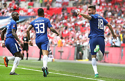 Chelsea's Olivier Giroud (right)celebrates scoring his side's first goal of the game with team-mates Emerson (centre) and Antonio Rudiger during the Emirates FA Cup semi-final match at Wembley Stadium, London.