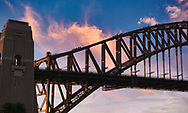 A view of the Sydney Bridge at sunset with bridge climbers.
