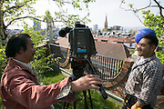 Andreas K. guiding a Japanese TV crew around the Hundertwasser House, the first and most famous public housing project by Austrian artist and architekt Friedensreich Hundertwasser.