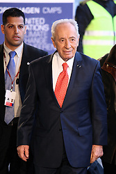 Israel's President Shimon Peres arrives at the morning session of United Nations Climate Change Conference at Bella Center in Copenhagen, Denmark, on December 18, 2009. World leaders will try to reach agreement on targets for reducing the earth's carbon emissions on this last day of the summit. Photo by Ludovic/Pool/ABACAPRESS.COM