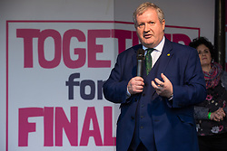 London, UK. 19 October, 2019. Ian Blackford, Leader of the Scottish National Party in the House of Commons, addresses hundreds of thousands of pro-EU citizens at a Together for the Final Say People's Vote rally in Parliament Square as MPs meet in a 'super Saturday' Commons session, the first such sitting since the Falklands conflict, to vote, subject to the Sir Oliver Letwin amendment, on the Brexit deal negotiated by Prime Minister Boris Johnson with the European Union.