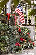 Christmas bows and roping decorate a historic home in Savannah, GA.