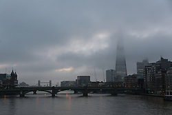 © Licensed to London News Pictures. 07/01/2017. LONDON, UK.  Mist and fog over the River Thames at first light this morning and the top of the London Shard is barely visible. The weather in London today is misty, foggy and much milder than it has been during the past week.  Photo credit: Vickie Flores/LNP