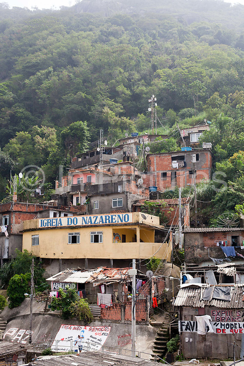Makeshift evangelical church at the top of favela Santa Marta in Botafogo on a misty day, Rio de Janeiro.
