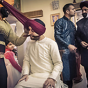 Preparing for the wedding, a young secular Sikh groom who does not wear the turban in his day to day life, has his turban tied by a professional. Chandigarh, 2011