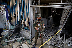 Aug. 29, 2017 - Kabul, Afghanistan - A security force member stands guard at the site of an attack in Kabul, Afghanistan. At least one person was dead and eight others were injured as a suicide bomber blew himself up near a bank in the Microrayani-eDuwum locality of Kabul on Tuesday, hospital sources said.  (Credit Image: © Rahmat Alizadah/Xinhua via ZUMA Wire)