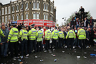 Riot Police holding a line outside Boleyn Ground before k/o.scenes around the Boleyn Ground, Upton Park in East London as West Ham United play their last ever game at the famous ground before their move to the Olympic Stadium next season. Barclays Premier league match, West Ham Utd v Man Utd at the Boleyn Ground in London on Tuesday 10th May 2016.<br /> pic by John Patrick Fletcher, Andrew Orchard sports photography.