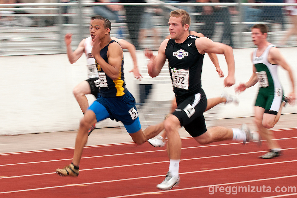Meridian senior Nic Bowens and Rocky Mountain senior Dallas Burroughs in the 100 meter finals during the Bandanna Invitational at Mountain View High School on April 16, 2011. Burroughs won the race in a meet record time of 10.67 and Bowens second place finishing time of 10.70 also eclipsed the meet record of 10.72 set by Burroughs in 2010.