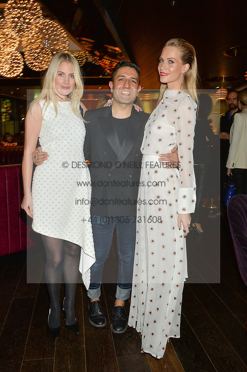 Left to right, MARISSA MONTGOMERY, OSMAN YOUSEFZADA and POPPY DELEVINGNE at the Launch Of Osman Yousefzada's 'The Collective' 4th edition with special guest collaborator Poppy Delevingne held in the Rumpus Room at The Mondrian Hotel, 19 Upper Ground, London SE1 on 24th November 2014, sponsored by Storm models and Beluga vodka.