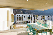 Balcony with outdoor furniture. Residence overlooking the hills