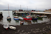 Fishing boats at low tide in the old port town of Cobh, Cork, Ireland.