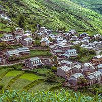 Terraced rice paddies surround a village in the Kali Gandaki Valley of Nepal.