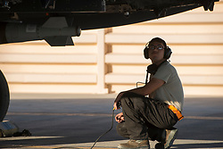 Airman 1st Class Connor Badton, 3911st Fighter Squadron assistant dedicated crew chief, inspects an F-15E Strike Eagle during Green Flag West, June 13, 2018, at Nellis Air Force Base, Nevada. The 391st FS participated in Green Flag to further enhance readiness by training on Close Air Support over the National Training Center, Fort Irwin, California. (U.S. Air Force Photo by Airman 1st Class JaNae Capuno)