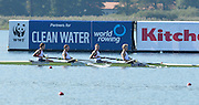 Varese,  ITALY. 2012 FISA European Championships, Lake Varese Regatta Course. ..Men's Lightweight Four. Repechage. GBR LM4- Bow. Sam SCRIMGEOUR, Adam FREEMAN-PASK, William FLETCHER, Jonathan CLEGG watching the second placed L/Four from Poland [POL LM4-] as  both crews  go through to Sundays Final...10:30:10  Saturday  15/09/2012 .....[Mandatory Credit Peter Spurrier:  Intersport Images]  ..2012 European Rowing Championships _ND43303.jpg.....