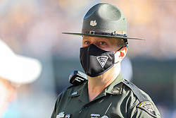 Sep 11, 2021; Morgantown, West Virginia, USA; A member of the West Virginia State Police watches along the sidelines during the first quarter against the Long Island Sharks at Mountaineer Field at Milan Puskar Stadium. Mandatory Credit: Ben Queen-USA TODAY Sports