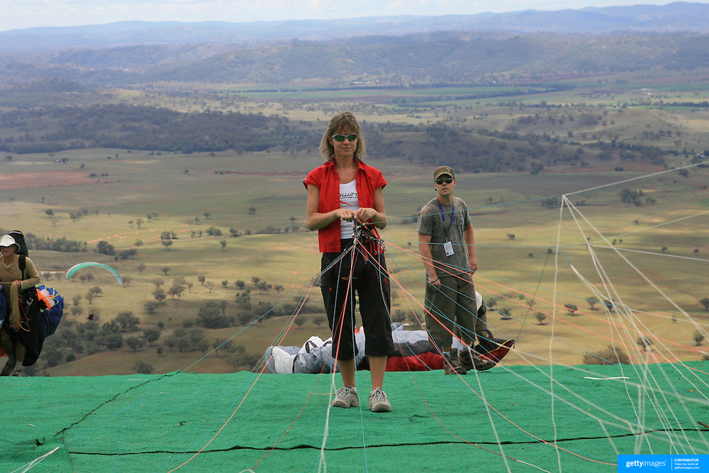 Ewa Wisnierska, the German Paragliders pilot who reached an altitude of 9947 metres and survived lightning, pounding hail, minus 40-degree temperatures and oxygen deprivation after a storm system sucked her to an altitude higher than Mount Everest as she prepared for the World Paragliding Championships in Manilla, Northern New South Wales..Ewa Wisnierska, 35, passed out due to a lack of oxygen and flew unconscious for up to an hour covered in ice after reaching an altitude of 9947 metres - near the cruising height of a jumbo jet. Her top speed of ascent was clocked at 20 metres per second and her descent at 33 metres per second by an on-board tracking system. The previous altitude survival record for a paraglider was 24,000 feet..Chinese pilot He Zhongpin, 42, was not so lucky, he was found 75 kilometres away from his launch site, and most likely suffocated or froze to death after being sucked into the storm..Ewa Wisnierska went on to compete in the Paragliding World Championships which took place between 24th February and 9th March 2007 where she finished 10th in the female division of the competition.....