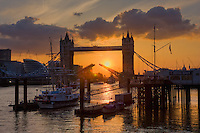 tower bridge opens at sunset in london england