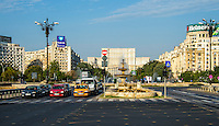 BUCHAREST, ROMANIA - September 29, 2012: View of Bulevardul Unirii, (Unification Boulevard) close the sqaure of the same name, in Bucharest,  a major thoroughfare in the city centre that ends in the Constitution Square and Palace of Parliament (seen on the background).
