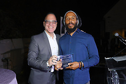 Steve Schnur and Ziggy Marley at Creative Community For Peace 2nd Annual 'Ambassadors Of Peace' Gala held at Los Angeles on September 26, 2019 in Private Residence, California, United States (Photo by © Jc Olivera/VipEventPhotography.com