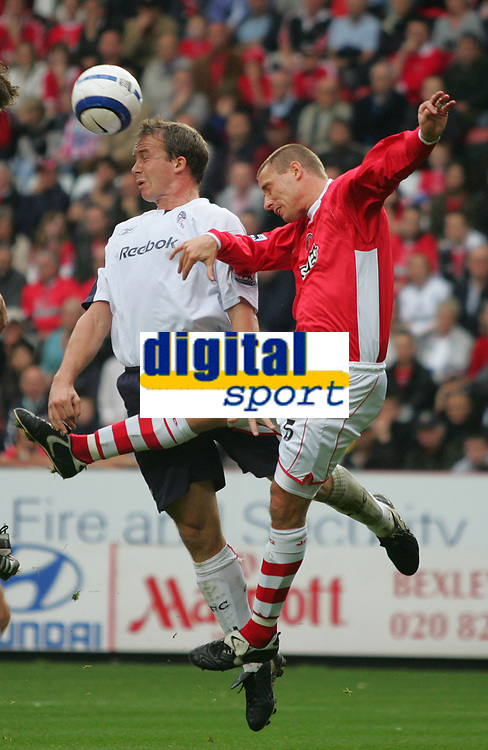 Photo: Frances Leader.<br />Charlton Athletic v Bolton Wanderers. The Barclays Premiership. 29/10/2005.<br /><br />Bolton's Kevin Davies and Charlton's Chris Perry head the ball.
