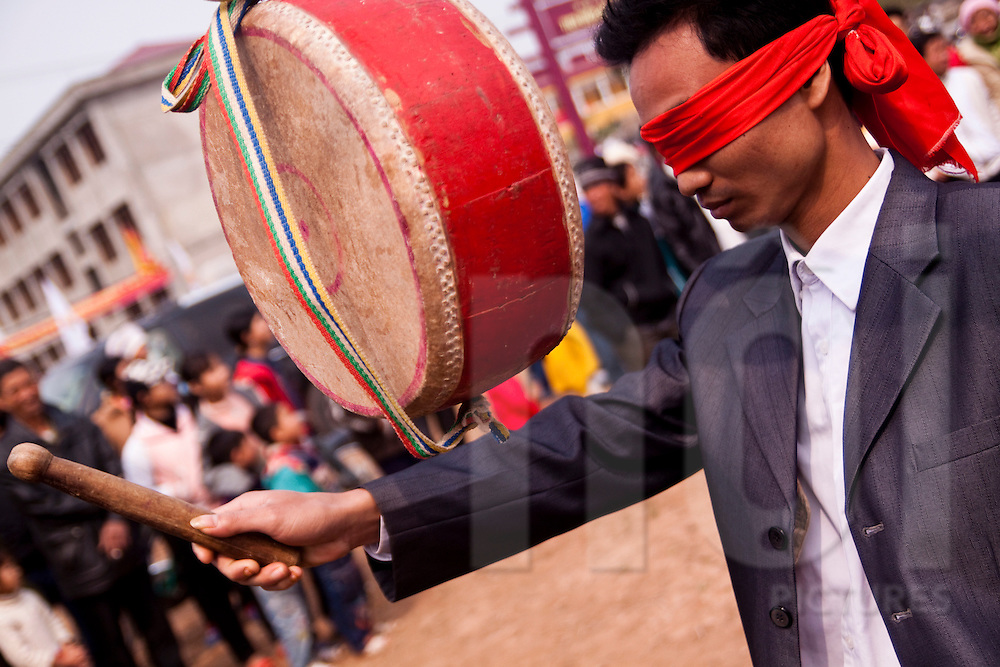 A man takes part in a game at the Buffalo Painting Festival outside Phu Ly, Vietnam.
