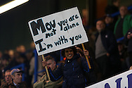 """a Chelsea Fan holds up a Jose Mourinho banner saying """" Mou you are not alone I'm with you"""" before k/o. UEFA Champions league group G match, Chelsea v Porto at Stamford Bridge in London on Wednesday 9th December 2015.<br /> pic by John Patrick Fletcher, Andrew Orchard sports photography."""