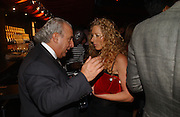 KELLY HOPPEN AND PHILIP GREEN. Party to celebrate the First issue of British Harper's Bazaar. Cirque, Leicester Sq. London. 16 February 2006. ONE TIME USE ONLY - DO NOT ARCHIVE  © Copyright Photograph by Dafydd Jones 66 Stockwell Park Rd. London SW9 0DA Tel 020 7733 0108 www.dafjones.com